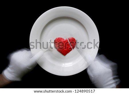 Eating of the human heart by the silverware tools. motion blur