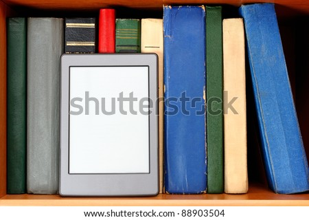 Ebook and old books on bookshelf