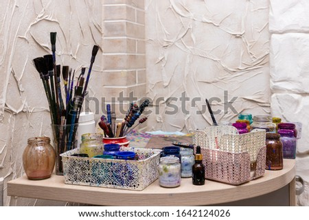 """Ebru Art, the Ancient Techniques of """"Painting on Water"""". Ebru paints, brushes and accessories, still life"""
