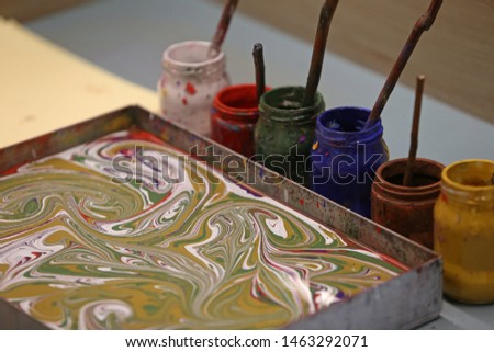 Ebru is a decorative art made by passing the patterns created with specially prepared paints on paper intensified with tragacanth on paper. #1463292071