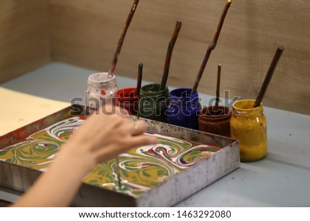 Ebru is a decorative art made by passing the patterns created with specially prepared paints on paper intensified with tragacanth on paper. #1463292080