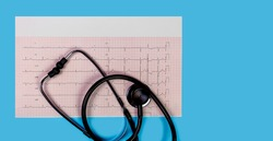 ECG 12 lead Cardiogram with stethoscope on  blue background, panorama