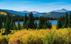 Echo Lake showing off her fall colors as seasons change and autumn colors come out in the Colorado Rocky Mountains near Mount Evans outside of Denver Colorado USA