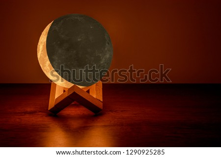 Eclipsed moon lamp on the table #1290925285