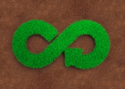 ECO and circular economy concept. The green grass in form of arrow infinity recycling symbol and red soil background.