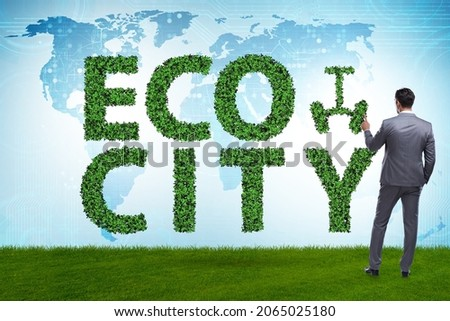 Eco city in ecology concept with businessman