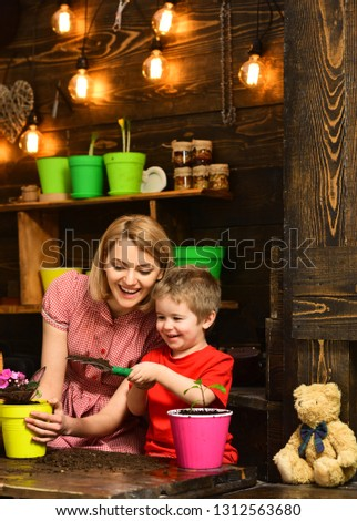 Eco concept. Eco and ecology. Be eco friendly and go green. Little child help mother planting flower to new pot, eco. #1312563680