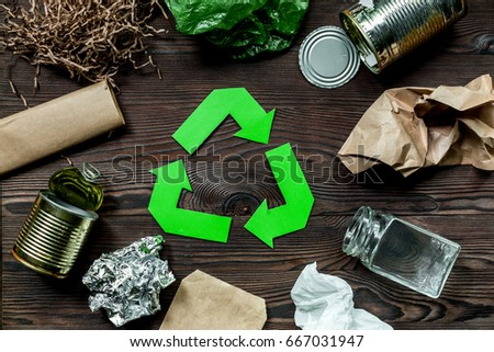 Eco concept with recycling symbol on wooden table background top view