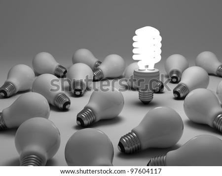 Eco energy saving light bulb concept, one glowing compact fluorescent light bulb amongst the unlit incandescent bulbs on white background