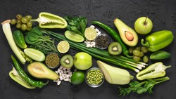 Eco food, detox nutrition. Vitamins, antioxidants and beneficial micronutrients in green foods for vegetarians and meat-eaters.
