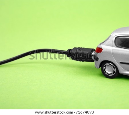 Eco-friendly car isolated on green background