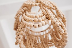 Eco friendly chandelier woven from wooden balls and beads in the Balinese style