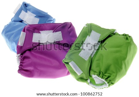Eco Friendly Cloth Diapers in Green, Purple and Blue Isolated on White.