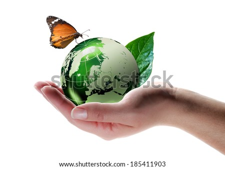eco-friendly concept - butterfly on planet in hand -  Elements of this image furnished by NASA