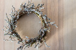 eco-friendly decoration for Easter in the form of a wreath of willow branches on a wooden table