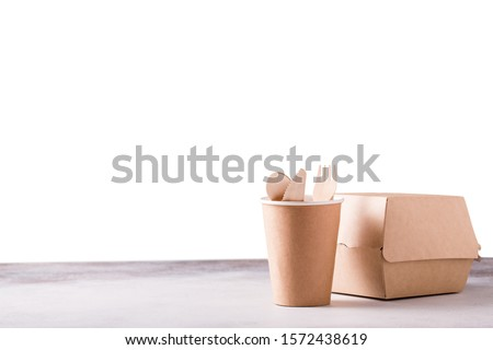 Eco-friendly fast food containers. Food eco packaging made from recycled kraft paper isolated on white background. Concept of environmental protection, nature conservation, recycle, zero waste.