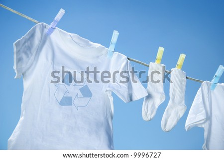 Eco- friendly  laundry drying on clothes line against a blue sky