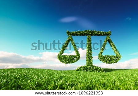 Eco friendly law, politics and eco balance concept. 3d rendering of scale icon on fresh spring meadow with blue sky in background.