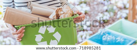 Eco-friendly person taking care of ecosystem by sorting paper to green container. Recycling concept #718985281