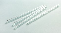 Eco friendly reusable glass straws on mint background