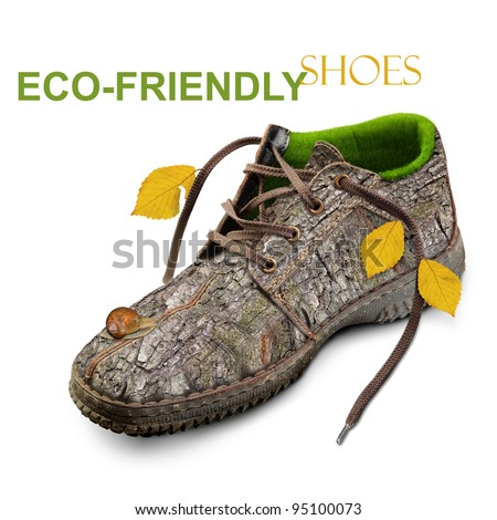 Eco-friendly shoes . Concept . Shoes made of natural materials. Winter shoes from the bark of a tree, grass and leaves. Go green  technology . Isolated over white background.