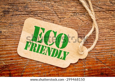 eco friendly  sign a paper price tag against rustic red painted barn wood - shopping concept #299468150