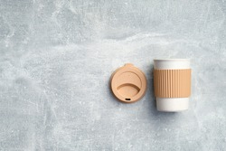 Eco-friendly takeaway coffee mug on stone background. Brown reusable bamboo coffee cup. Zero waste, sustainable lifestyle concept. Flat lay, top view