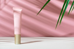 Eco-friendly tube with face cream. Women's care cosmetics with natural composition. Feminine hygiene product for facial skin care. Skincare, organic balm, soft lotion. Copy space, mockup