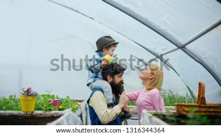 eco life. eco life concept. happy family has eco life. eco life for happy family in greenhouse. flowers presentation