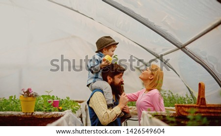 eco life. eco life concept. happy family has eco life. eco life for happy family in greenhouse. flowers presentation #1426549604