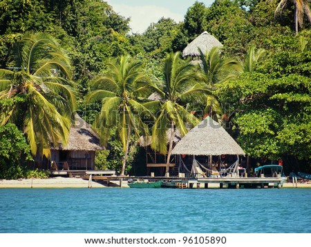 Eco resort on a Caribbean beach with thatched huts and lush tropical vegetation, Bocas del Toro, Panama
