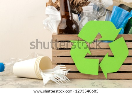 Eco symbol and trash in the box. recycling. waste recycling. on a light background