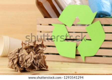 Eco symbol and trash in the box. recycling. waste recycling. on natural wooden background