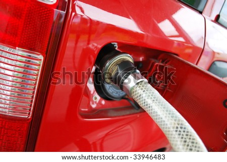 Ecologic methane red car fueling detail