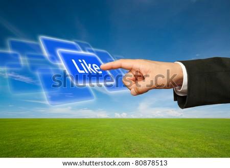 Ecological concept, finger of businessman pessing likeblue button.