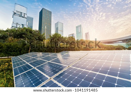 Ecological energy renewable solar panel plant with urban landscape landmarks