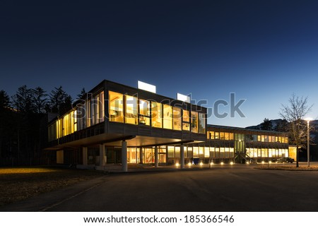 ecological energy saving wooden office building at night