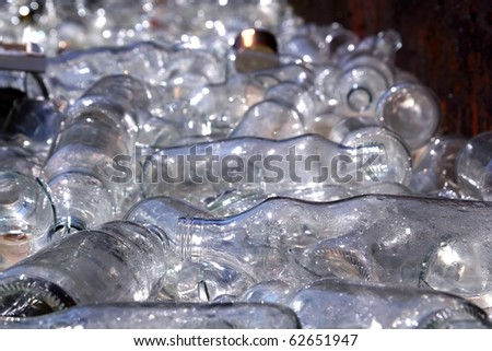 ecological recycling glass bottles in messy container