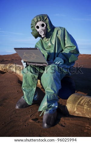 Ecologist scientist in ecological disaster zone with laptop