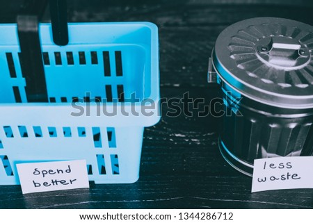ecology and consumerism concept: spend better for less waste shopping basket next to gargabe bin