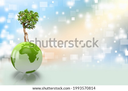 Ecology and nature protection concept. Green tree growing from planet earth.