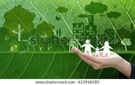Ecology concept design of business woman hand holding white paper family symbol on fresh green leaf texture background #653968285