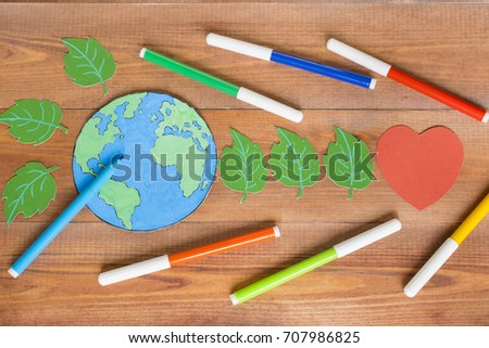 Ecology concept, painting a paper globe map blue and green, wooden background.  #707986825