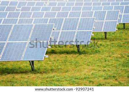 Ecology electric energy farm with solar panel battery in green field