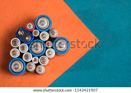 Ecology recycling concept. Many different types used or new battery, rechargeable accumulator, alkaline batteries on color background. Nature energy #1143421907