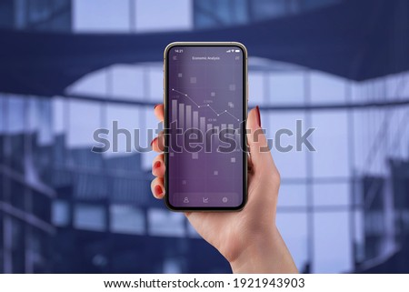 Economic analysis app concept with chart of the economic decline on smart phone in woman hand