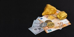 Economic concept: Crypto currency, money and gold on global stock markets. Three coins, BTC, LTC and ETH. Two gold pieces lying on some EURO and US dollar banknotes. Black background with copy space