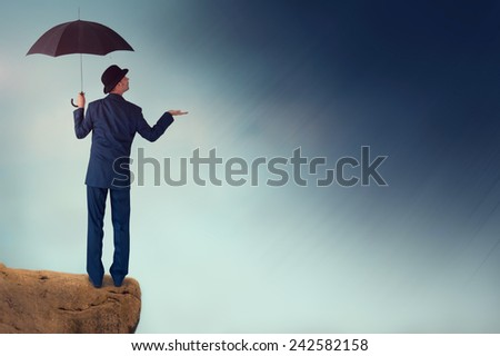 economic forecast outlook concept businessman with umbrella