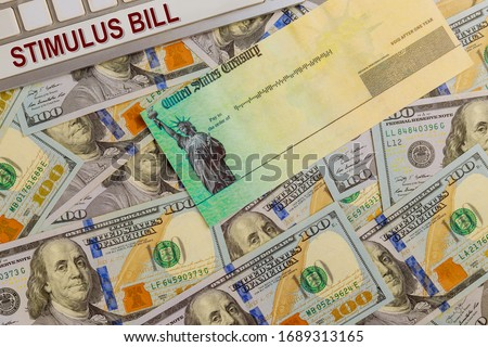 Economic government relief Word COVID-19 on global pandemic lockdown on financial lockdown from government US 100 dollar bills currency Photo stock ©