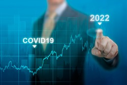 economic recovery in 2022. timeline chart diagram of global economic recovery after crisis caused by covid19 pandemic. Businessman pointing graph growth plan on dark blue. restart economy after crisis